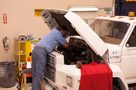 FHSD employee doing truck maintenance
