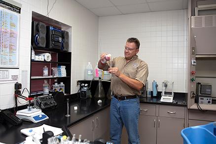 District employee running test in lab