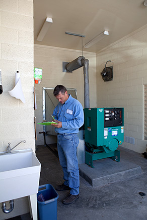 FHSD employee checking levels of pump station