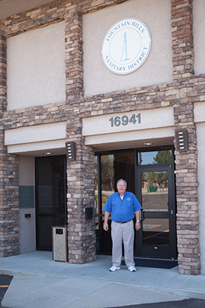 Ron Huber District Engineer in front of Adminstration building