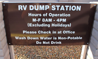 RV Dump Station Sign showing hours of operation